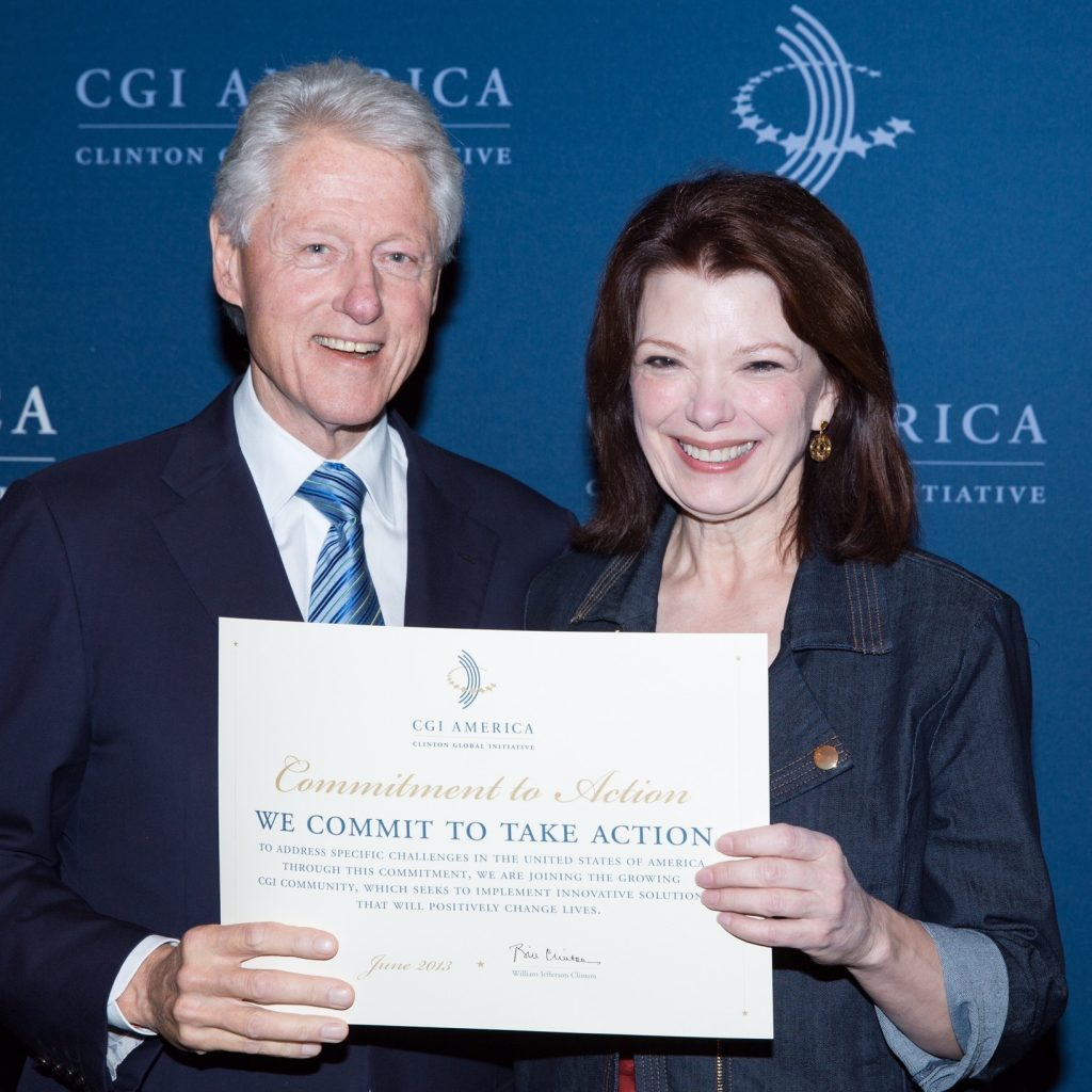 Angela with former President Bill Clinton at the Clinton Global Initiative
