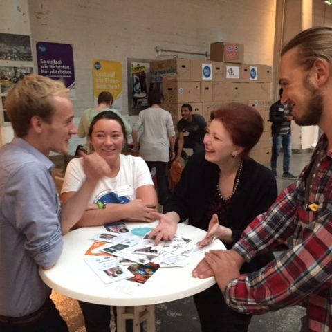 Angela in Hamburg, Germany meeting with volunteers serving newly arrived refugees